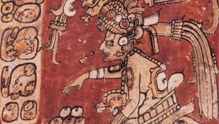 Изображение божества Ицамна, которому приносят подношения из какао-бобов и шоколадных напитков
