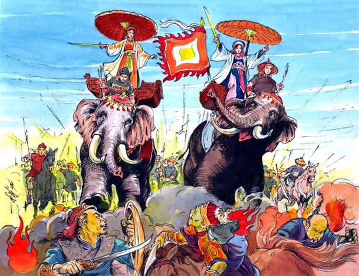 Сёстры на боевых слонах: Чак - в жёлтом, Ньи - в красном.