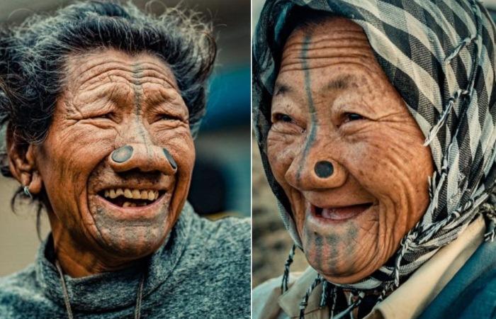 Женщины народа апатани носят втулки в носу.