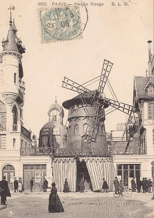 Старая открытка, на которой рядом с мельницей можно увидеть слона