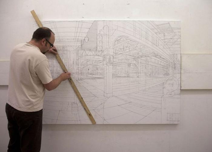 Натан Уолш в процессе работы над одной из своих картин