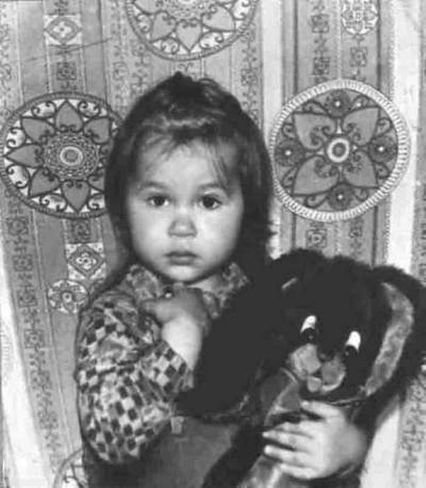 Саша Путря с любимой игрушкой.