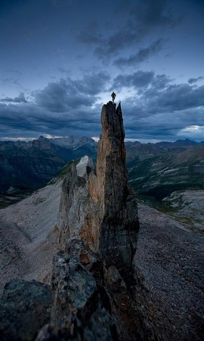 человек на вершине горы Олимп
