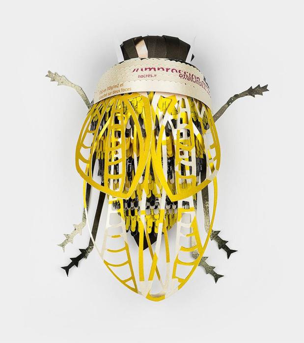 Искусные бумажные поделки в виде насекомых.