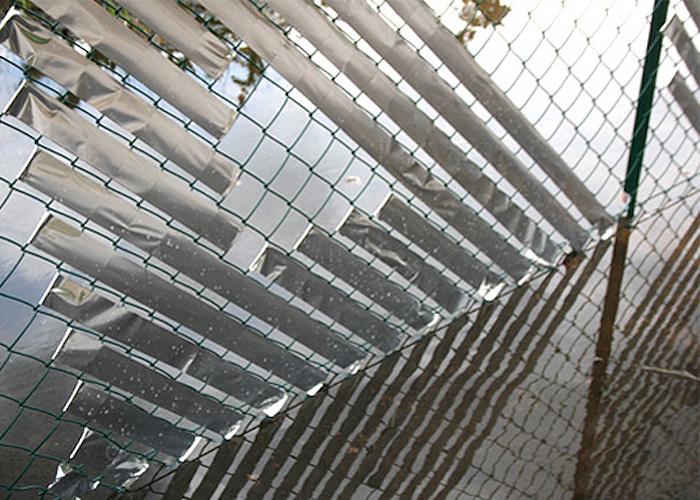 Стрит-арт на заборе от  Анны Гарфорт (Anna Garforth).
