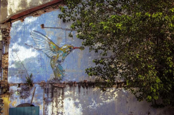 Причудливые рисунки на стенах городских построек от Эрнеста Захаревича (Ernest Zacharevic).