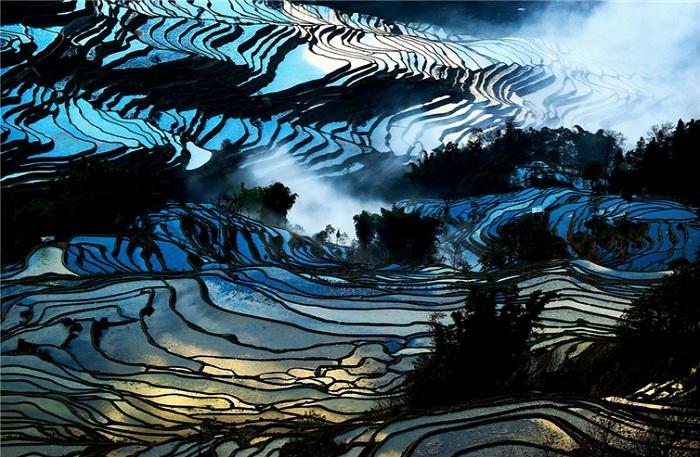 Невероятное зрелище рисовых полей в районе Yuanyang (провинция Юньнань, Китай).
