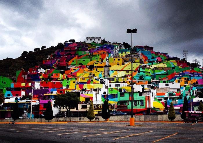 Уличные художники Germen Crew раскрасили фасады зданий города Пальмитас.