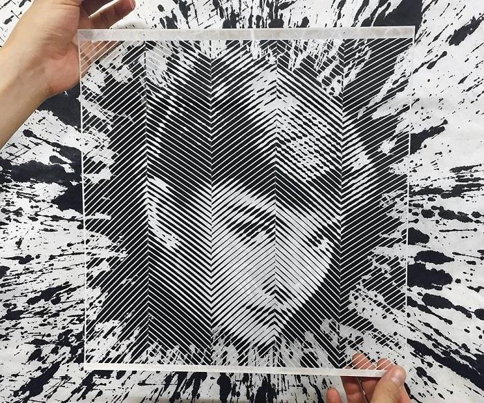 Объемные портреты, вырезанные из бумаги.