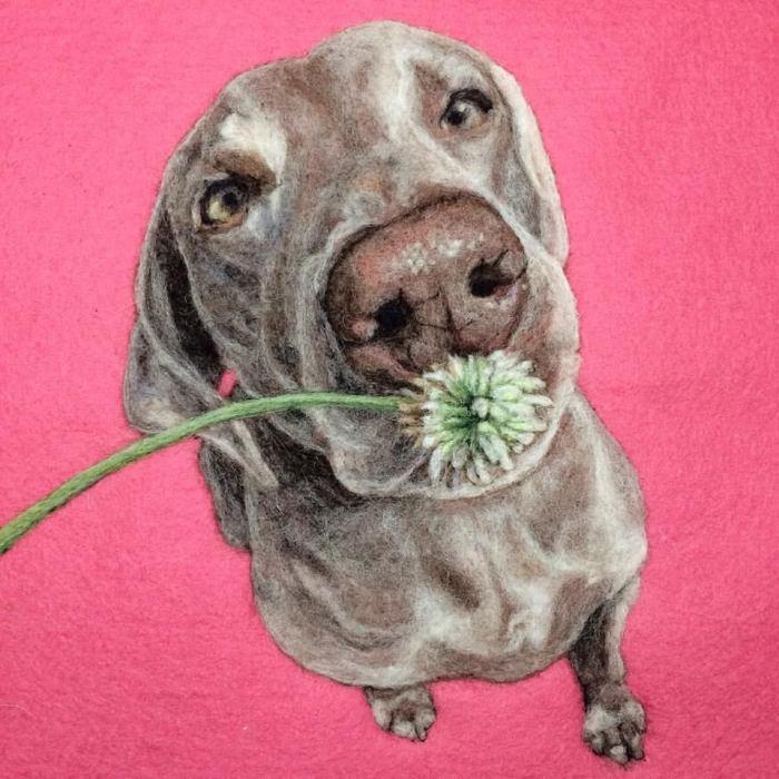 Собака, нюхающая цветочек. Автор Dani Ives.