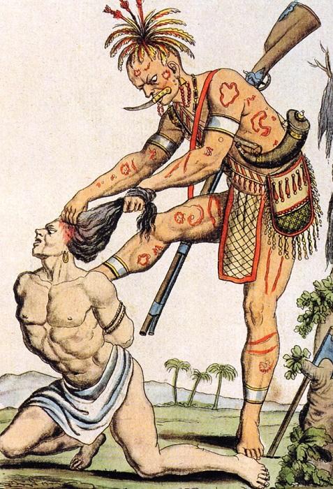 Индеец снимает скальп с врага. | Фото: 24.media.tumblr.com