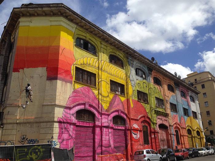 Оригинальное красочное граффити от художника Blu.