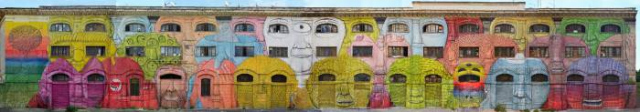 27 лиц, нарисованных на стене.