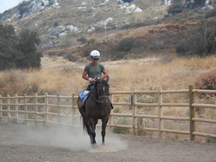Он даже может кататься на лошади.