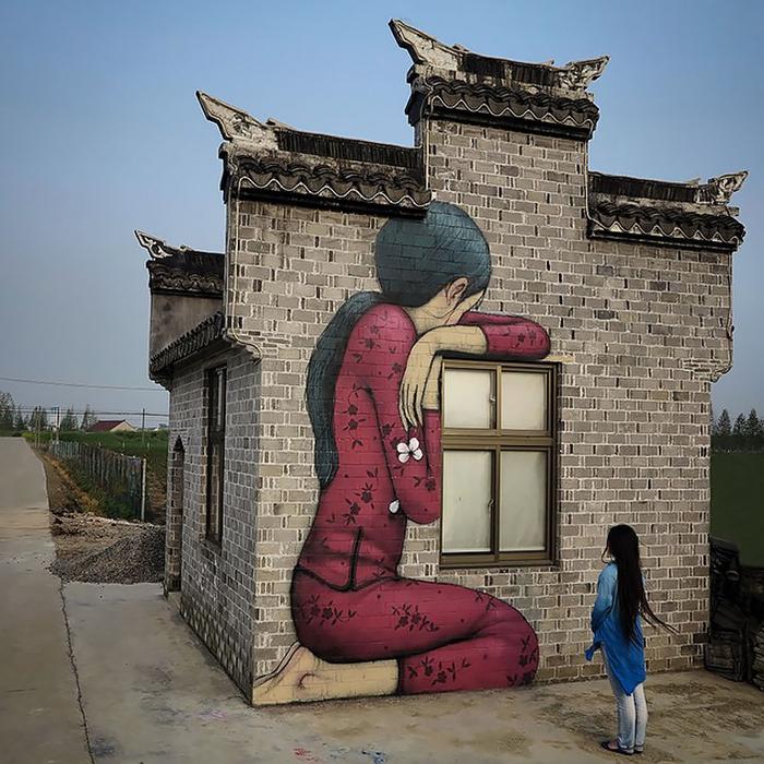 Граффити на окраине города. Автор: Julien Malland.