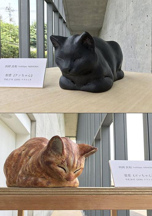 Деревянные скульптуры Го и Кена в музее.