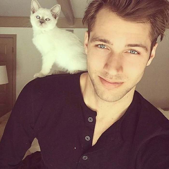 Hot dudes with kittens.
