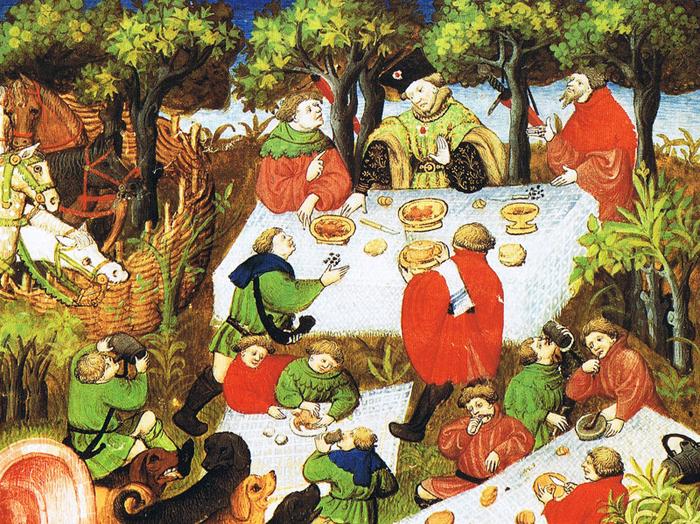 На картине благородные люди принимают пищу на  природе. Французское издание *Книги об охоте* Гастона Фебуса, XV век.