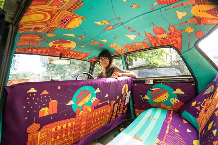 Изображение местных достопримечательностей в росписи такси Мумбаи.