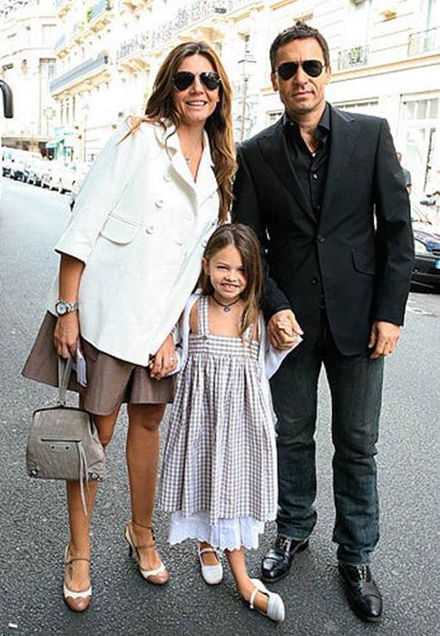 Тилан с родителями.