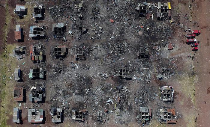 Снимок с воздуха последствий пожара на рынке фейерверков в Мексике. В результате взрыва погибло как минимум 32 человека. 21 декабря 2016. Фото: Mario Vazquez.