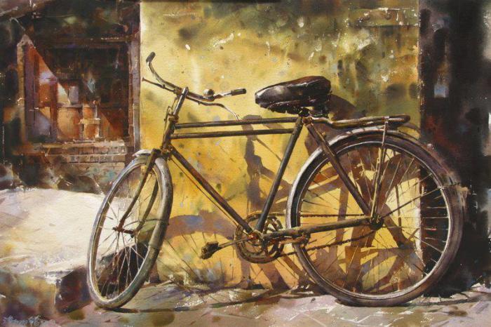 Велосипед у стены.