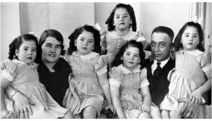Эльзир и Олива Дионн со своими пятерняшками.