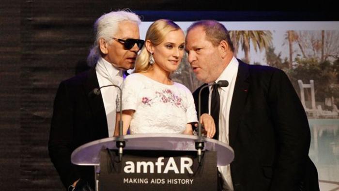 Дизайнер Карл Лагерфельд, актриса Диана Крюгер и Харви Вайнштейн на благотворительном вечере в Нью-Йорке.