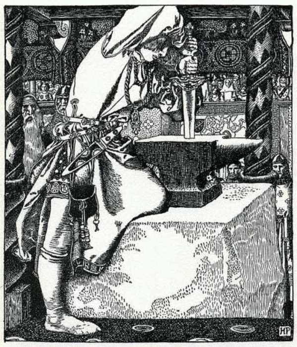 Король Артур достаёт из камня  меч.