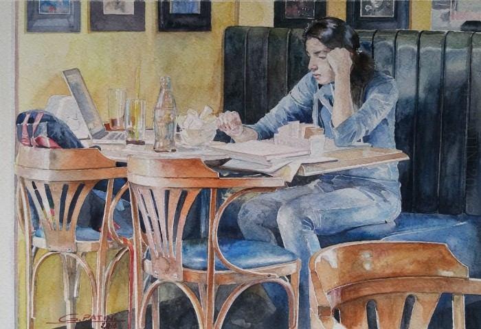 За столиком в кафе. Автор: Gael Patin.