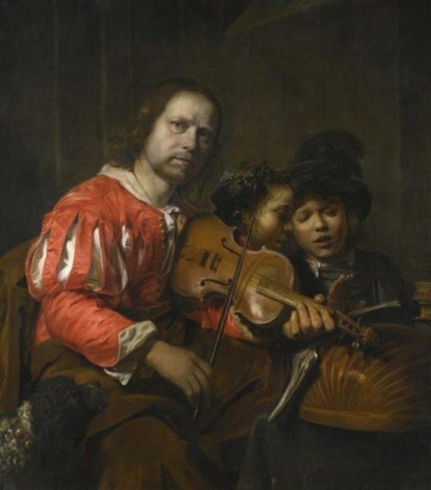 Скрипач, аккомпанирующий двум молодым певцам.  Автор: Jan de Bray.
