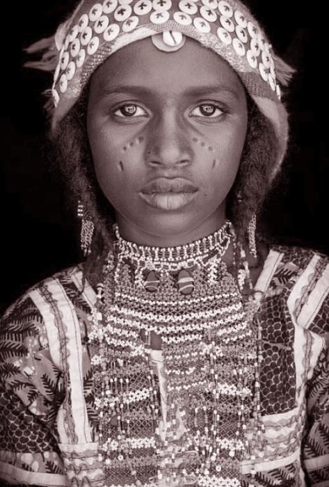 Племенная жительница Западной Африки. Автор: John Kenny.