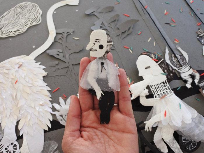 Фрагменты, вырезанные из бумаги. \ Фото: k.sina.cn.