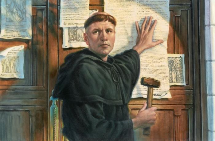 Изображение Мартина Лютера, прибивающего свои 95 тезисов к двери церкви. \ Фото: tinlanh.ru.
