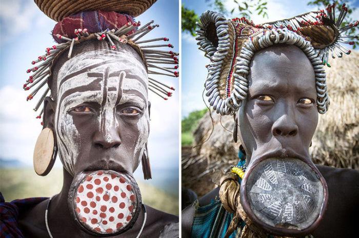 Женщины-мурси украшают свои губы своеобразным пирсингом.