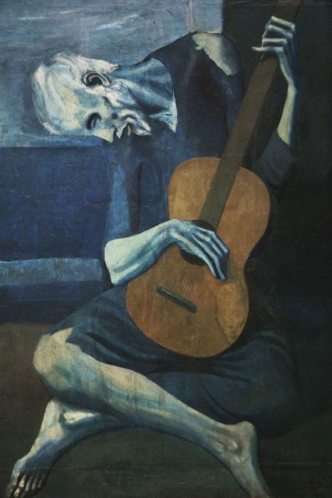 «Старый гитарист» — картина Пабло Пикассо. \ Фото: pinterest.at.