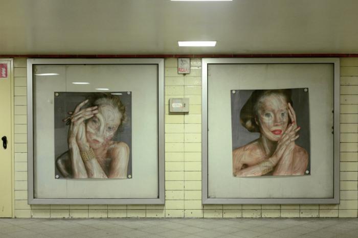 Он крадёт рекламные постеры, а после возвращает их в новом виде. Работы уличного художника Вермибус (Vermibus).