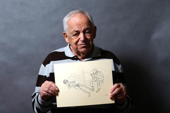 Лайош Эрдели (Lajos Erdelyi) держит в руках рисунок сокамерника.