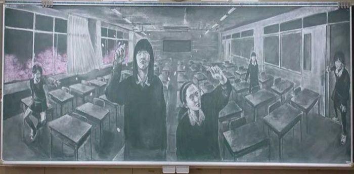 В классе.