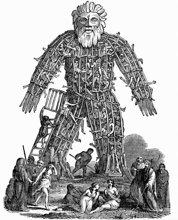 Гравюра на дереве 1832 года, изображающая друидов, готовящих плетеную конструкцию, наполненную живыми людьми, для сожжения в качестве жертвоприношения. \ Фото: thesun.co.uk.