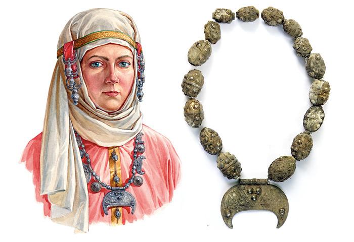 Женщина в уборе с гроздевидными наушниками, лунницами и щитовидными подвесками, конец X – начало XI в. По материалам кладов из Гнёздово под Смоленском.