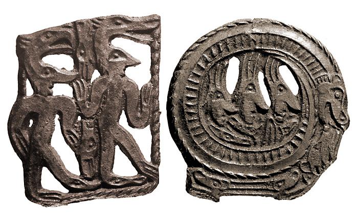 Свернувшийся в кольцо хищник, в центре кольца три человеческие головы, внизу-двухголовый ящер. (Пермский звериный стиль. Бронза, литье.)
