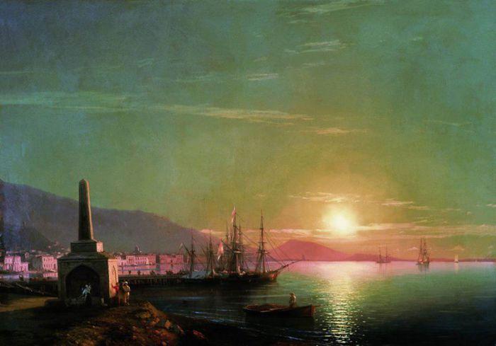 Восходящее солнце над тихой морской гладью.