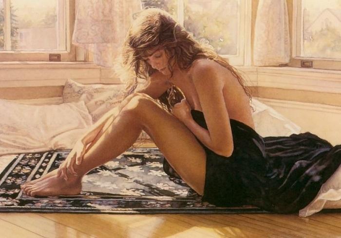 Девушка, наклонив голову, сидит в раздумии на ковре.