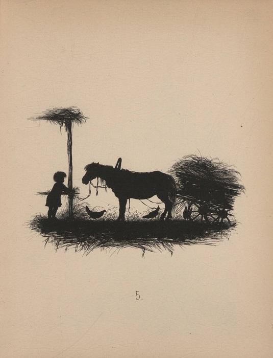 Мальчишка кормит лошадь.