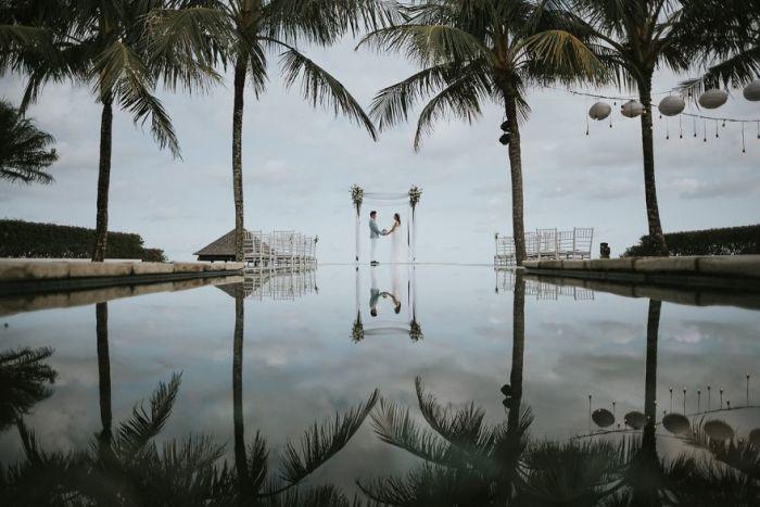 Небольшая репетиция под пальмами перед предстоящей церемонией. Автор фотографии: (Mang His) Манг Хрис.