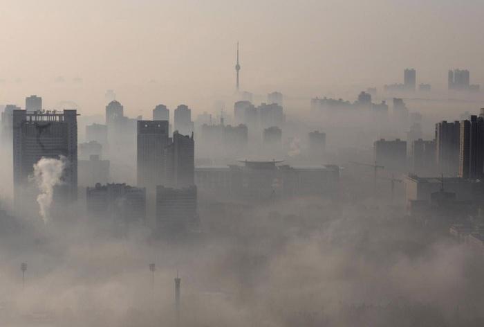 Город в облаках. Фото Reuters.