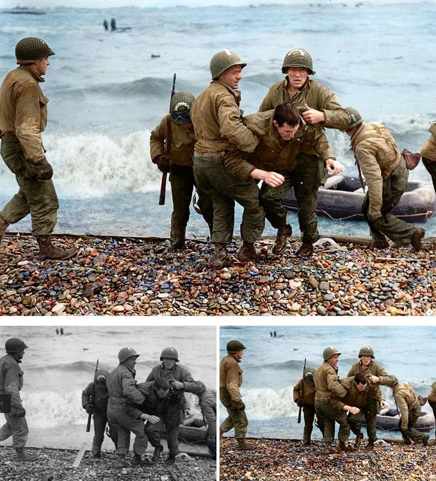 Американские десантники выбираются из воды на пляж Омаха.