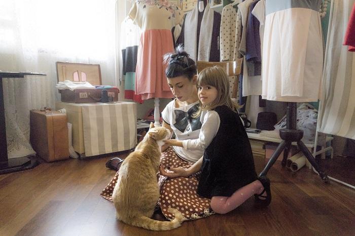 Рыжий кот, который живет в ателье мод, пользуется большой популярность.