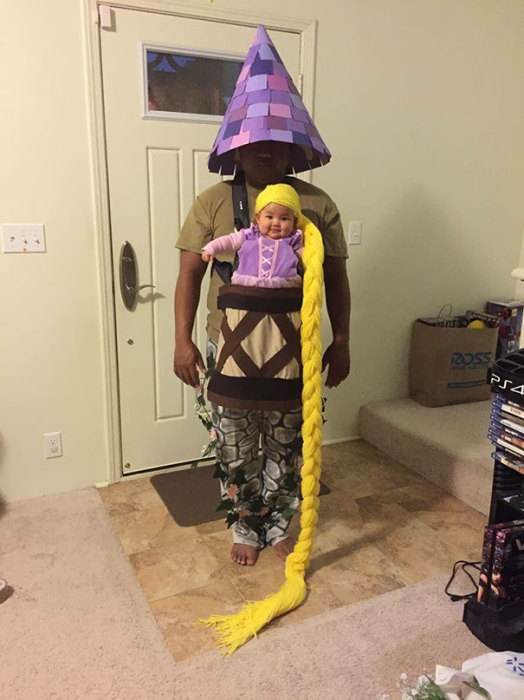 Маленькая Рапунцель с длинными волосами и папа в роли башни, в которой ее заперла мачеха.